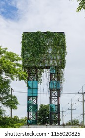 Old abandoned advertising billboard and covered with vines.The concept of business failure.