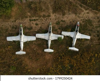Old abandoned airfield with abandoned planes. Aerial top view.