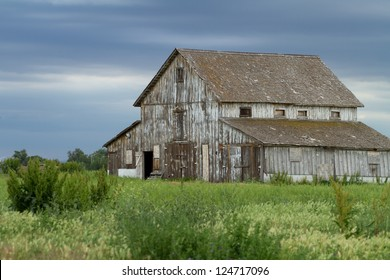 Old abandoned barn, decaying in eastern Colorado in late Spring.