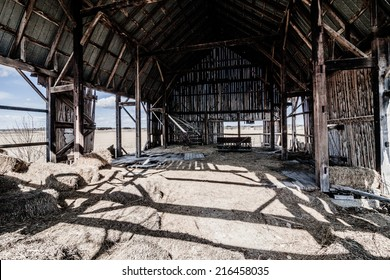 Old abandoned Barn and Haystack and destroyed walls