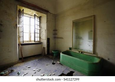 Old abandoned bathroom with window