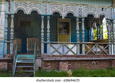 Old abandoned beautiful wooden house with carved polisade. The village of Pushcha-Voditsa, Kiev region, Ukraine.