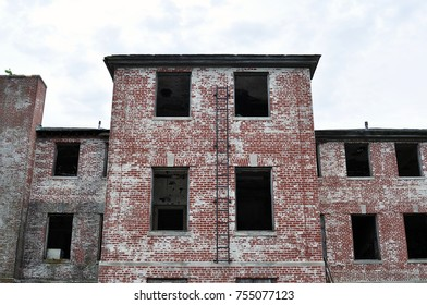 Old abandoned big brick building with broken windows