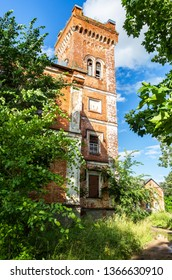 Old abandoned brick building in summer day. Gverstyanka Manor 1840-1890 (former summer residence of the founder of the refractory industry Constantine Wachter) in Borovichi, Russia
