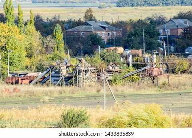 Old abandoned buildings of the former factory and warehouses. The destroyed essential oil plant. Soviet heritage. Old brick buildings. Settlement in the Kuban