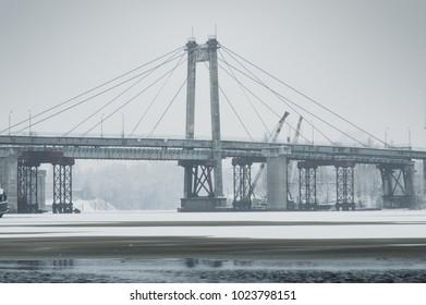 Old abandoned cableway bridge. Rybalskiy bridge on Podil, Kiev, Ukraine