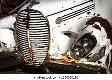 Old abandoned car close up