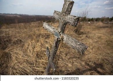 the old abandoned cemetery, the buried homeless and people without relatives, nameless graves with simple cheap wooden plates instead of gravestones, oblivion and eternal rest on a churchyard