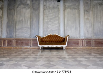 An old abandoned chair left in an abandoned dilapidated building. Interesting how the colors of the building and the chair match- space for copy,Chair of the mortar,