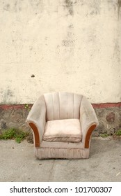 old abandoned chair left in a street