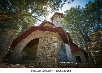 Old abandoned christian church in the forest of Profitis Ilias mount in Rhodes
