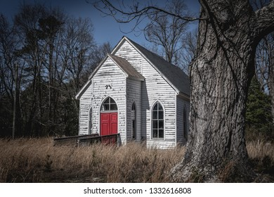 Old Abandoned Church with red door country rust wheat grass