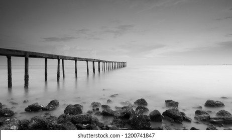 Old abandoned concrete jetty left alone during sunset