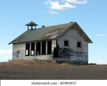 old abandoned country school house on the prairie