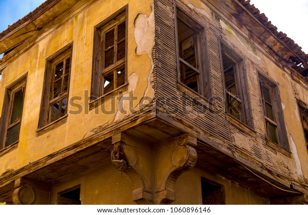 Old abandoned and damaged wooden house detail in Gemlik, Turkey