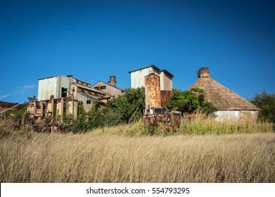Old abandoned & derelict sugarcane factory on the small island of Kauai, Hawaii.