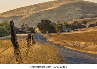 Old abandoned dilapidated California ranch along the road