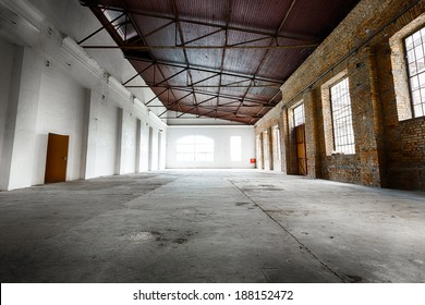 an old abandoned empty warehouse interior