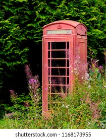 Old abandoned English style telephone booth