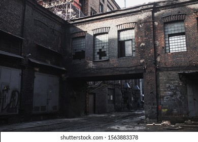 Old abandoned factory. Gothic industrial background. Scary place. Post apocalyptic landscape. Halloween party place. Abandoned buiding. Industrial grunge background. Nuclear war. Creepy factory