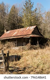Old Abandoned Farm House with Rusted Tin Roof, Falling Apart