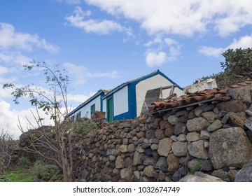 Farm wall images stock photos vectors shutterstock old abandoned farm traditional rural house with stine wall in tenerife ananga mountain with blue malvernweather Images