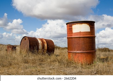 Old abandoned fifty five gallon drums held toxic chemicals