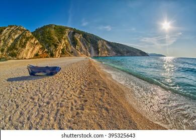 Old Abandoned Fishermen Boat at Empty Sunset Myrtos Beach in Kefalonia, Greece