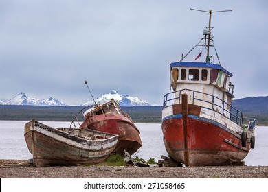 Old abandoned fishing boats near Puerto Natales in Patagonia in southern Chile, South America. Puerto Natales is located at the opening of Ultima Esperanza Sound, northwest of Punta Arenas.