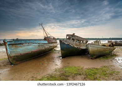 Old abandoned fishing boats on the River Orwell estuary at pin Mill on the coast of Suffolk
