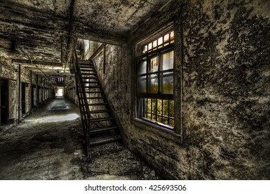 An old abandoned hallway and a staircase