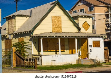 Old Abandoned Home With Boarded Up Windows & Door