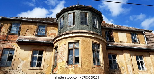 old abandoned house with broken windows