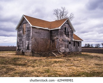 Old abandoned house in a field in the American Midwest