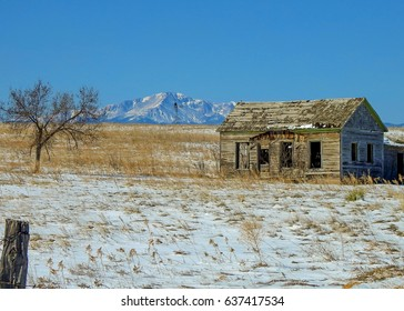 Old abandoned house located in Elbert County, Colorado with Pikes Peak in the background.