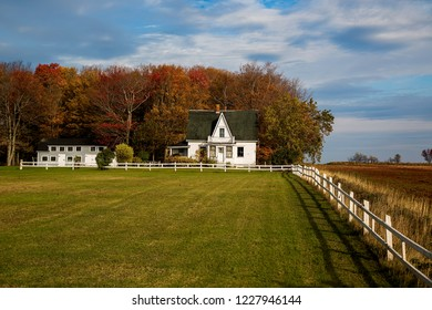 An old abandoned house on a farm yard in the fall.