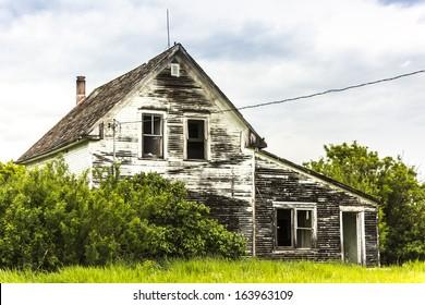 An old abandoned house on a farm yard