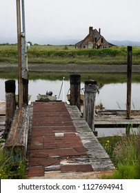old abandoned house and river dock