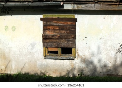Old abandoned house with  the window boarded up