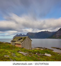 Old abandoned huts stand in impressive landscape. That's how it looks when humanity disappears. Senja is a beautiful place to take this kind of photos.