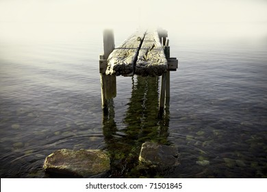 old abandoned jetty in the fog