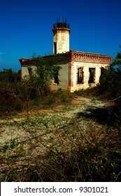 Old abandoned lighthouse in Guanica, Puerto Rico. Typical spanish colonial architectural style.