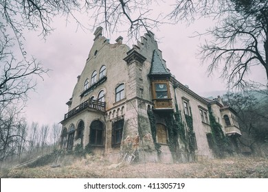 Old abandoned mansion in mystic spooky forest
