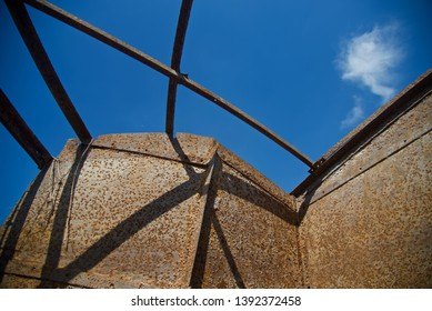 An old abandoned metallic structure with blue sky background photo