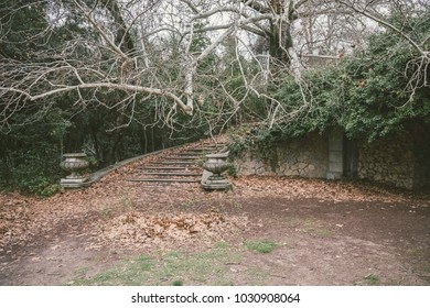 old abandoned park with ruined neoclassical constructions