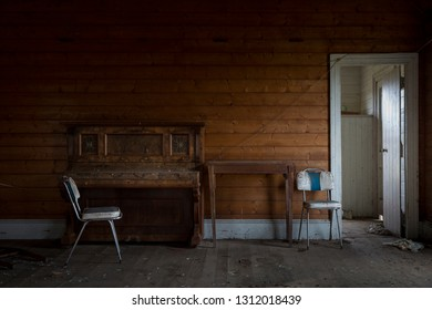 Old abandoned piano and chair in Tasmania