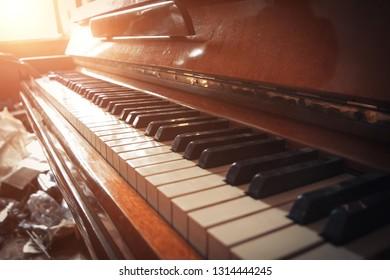 Old abandoned piano keyboard. Close up view.