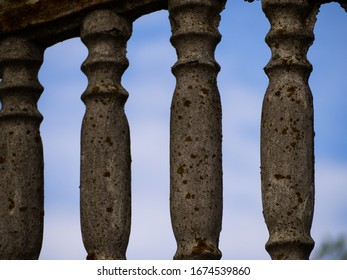 Old abandoned railing in summer. Concrete columns railing with moss.