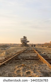 Old abandoned railway track. Giant stacker. Bucket chain excavator in a sand quarry. Bulk material handling