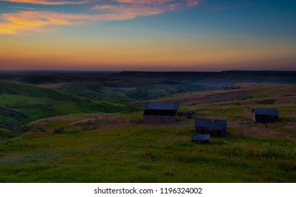 Old abandoned ranch buildings in Montana at sunset